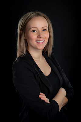 Casey Cole is a travel agent at Mode Travel Agency.